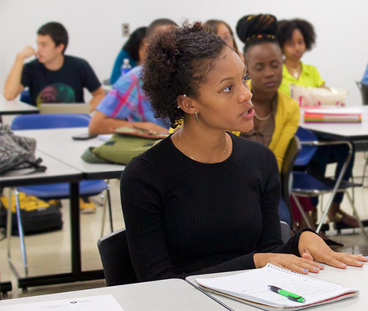 Woman in class at desk
