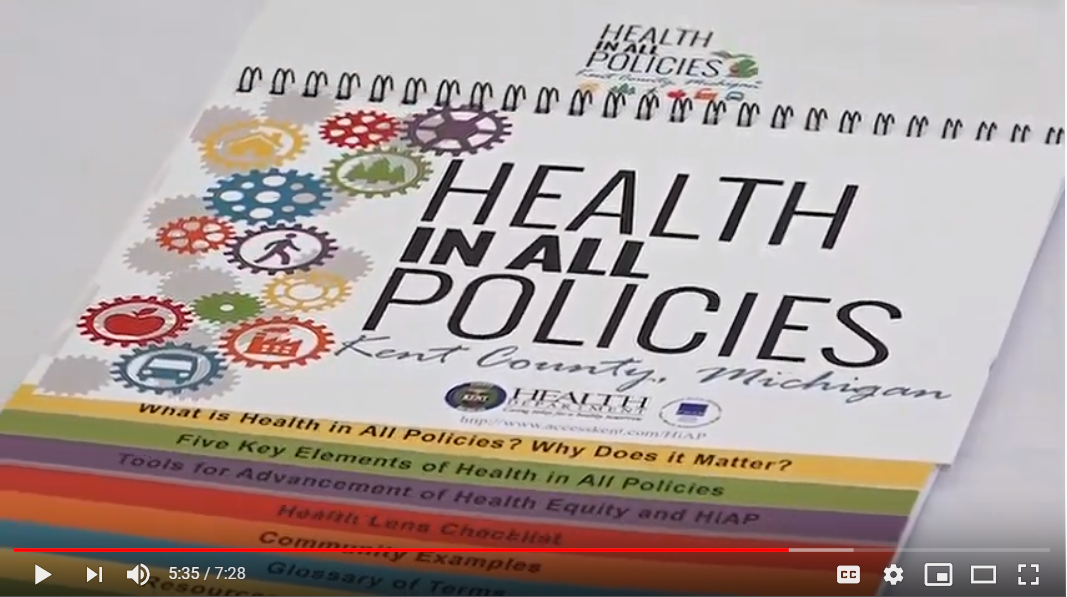 "Screenshot from a video, showing the ""Health in All Policies"" guide for Kent County, MI"