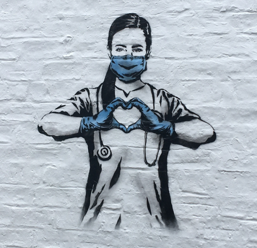 Spraypainted mural of a healthcare worker