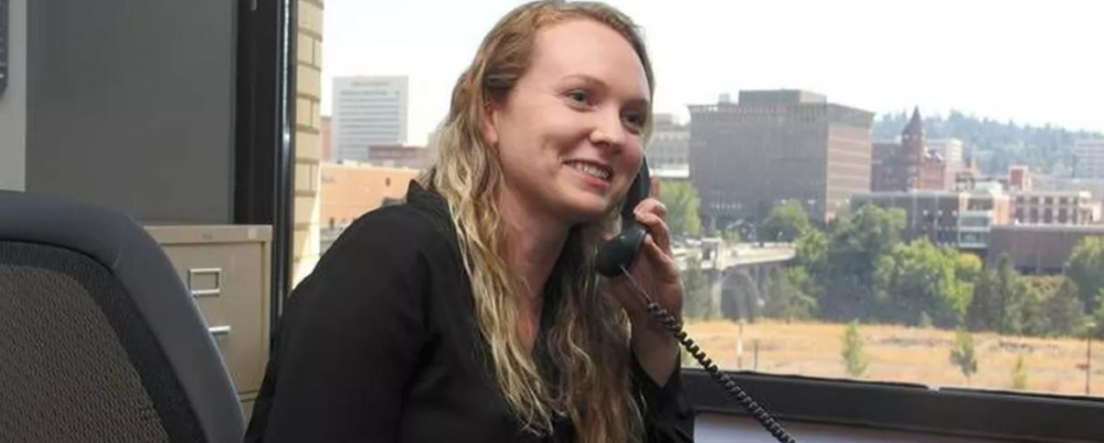 a woman in an office on the phone
