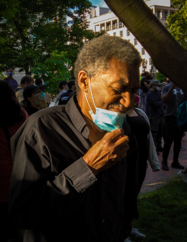 an older African American man wearing a medical mask